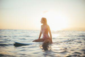 surfer sitting surfboard