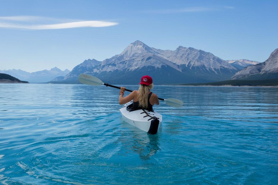 kayaking blue girl