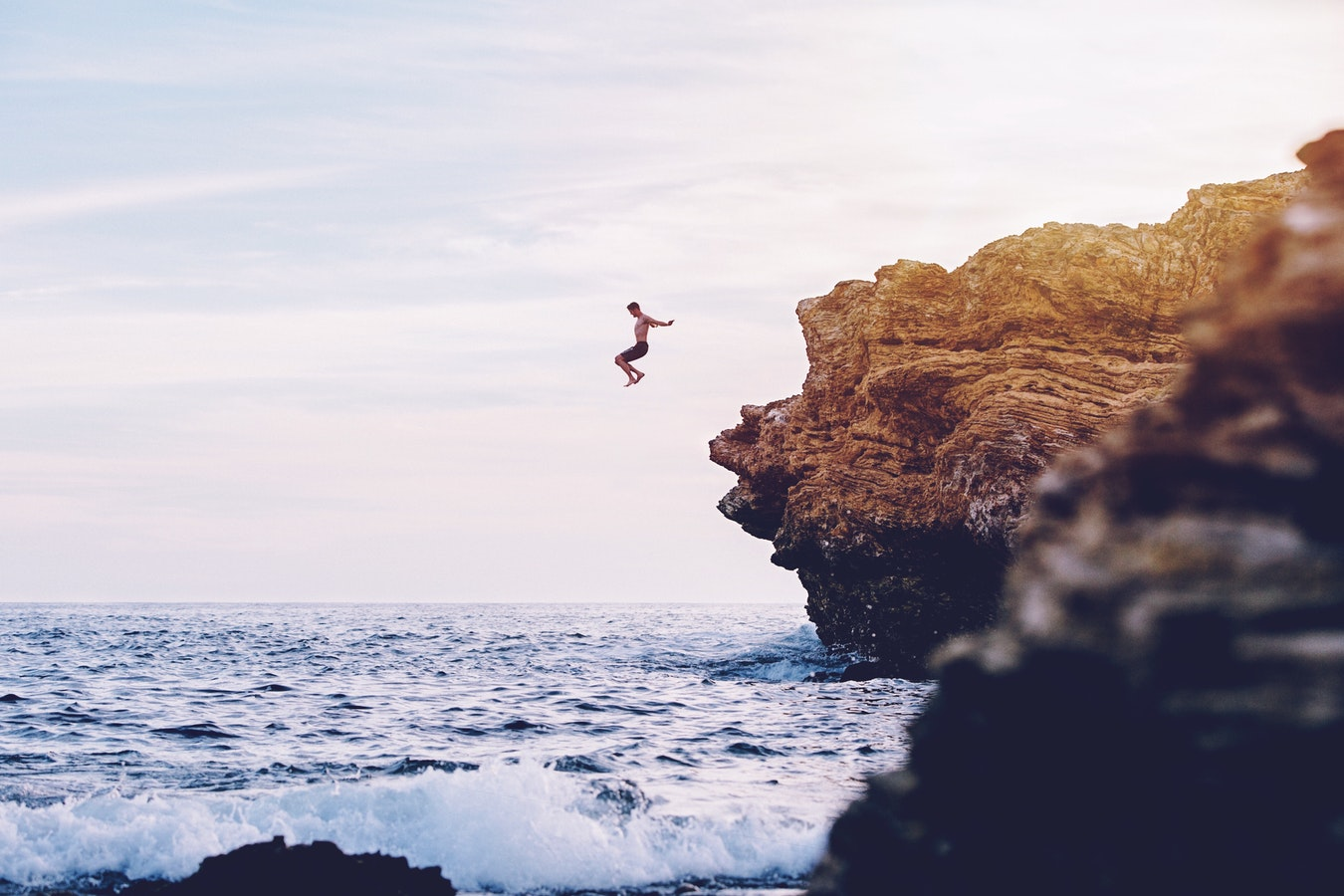 cliff jumping sunset