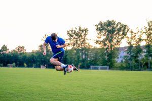 man jumping football