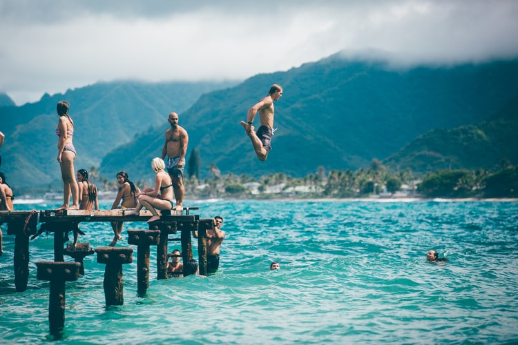 men jumping to water