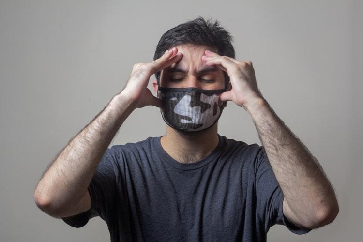 headache man with mask